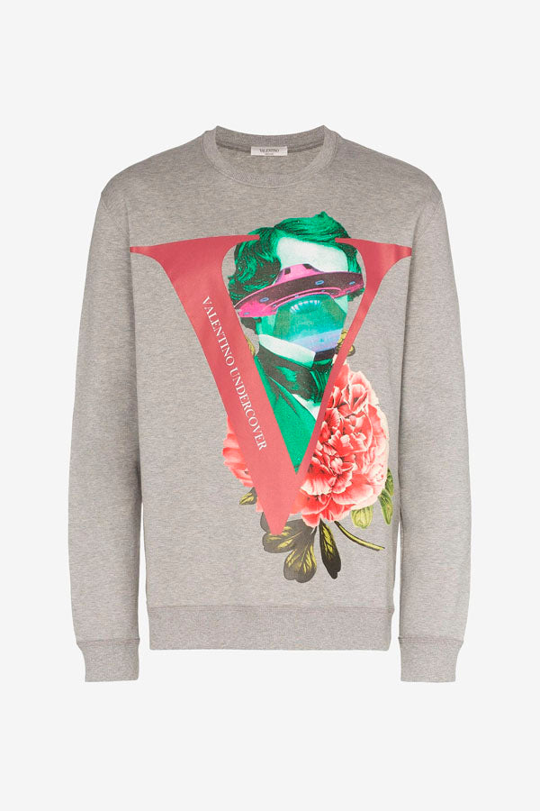 Sweatshirt in light grey, with a ribbed crewneck, bottom sleeves and hem. Front facing graphic print of, a large V, a red rose and a UFO.