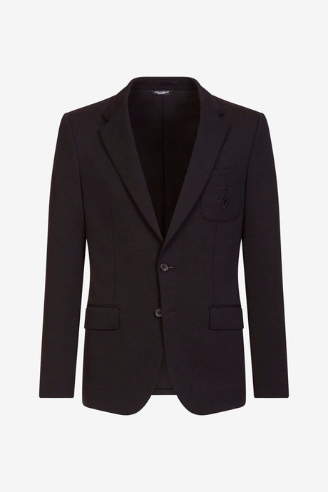 Blazer in black wool with a chest pocket that carry a D&G logo.