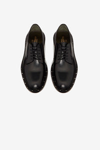 Derby shoes in black calfskin, with ruthenium stud-detailing on the welt.