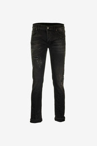 Slim jeans in washed black cotton with distressed details.