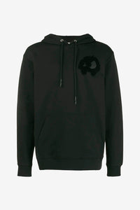 Black hoodie with a tone in tone graphic logo on chest. The hood has a drawstring fastening.