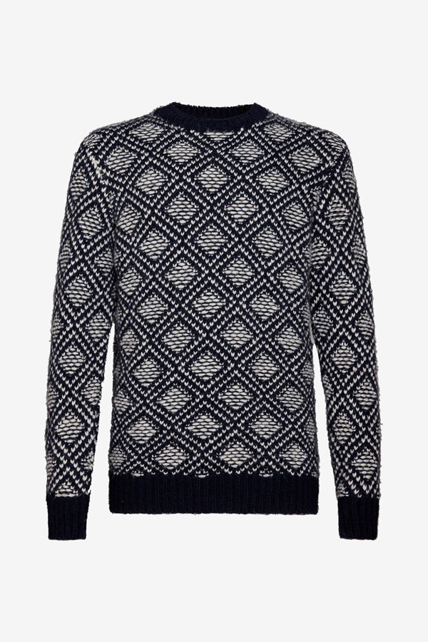 Sweater with a two-tone diamond knit pattern, in navy and white with rib-knit edges.
