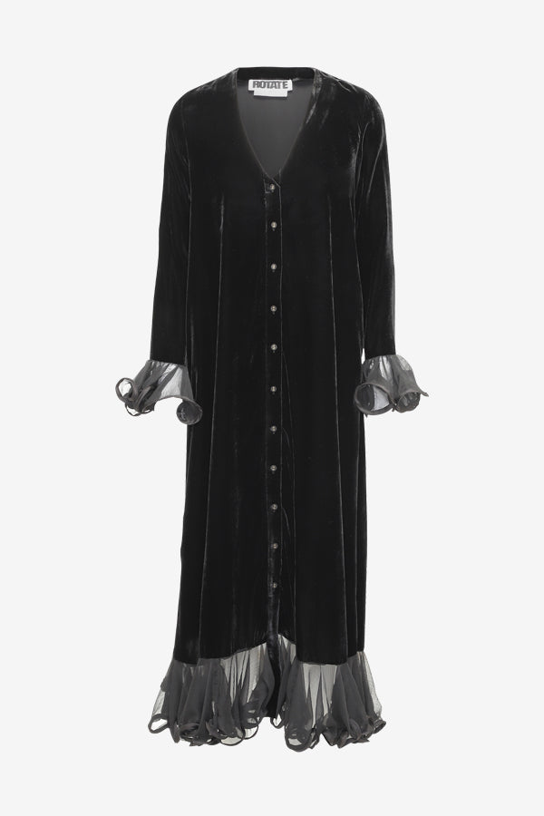 Long velvet dress with v-neck, button closure at the front and ruffle details