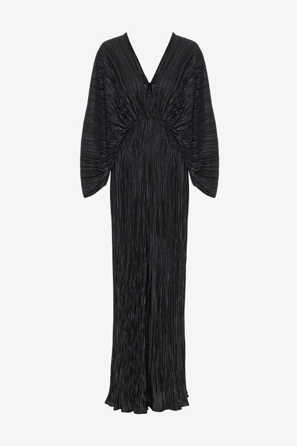 Black dress in a jumpsuit silhouette, with long sleeves, draped details and, a deep v-cut back and front.
