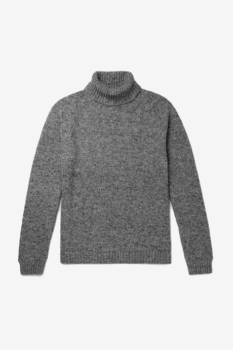 Regular fit rollneck sweater in a black and grey melange. The cuff and hem is in a rib-knit, like the rollneck that is more heavy.