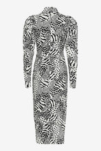 Long high neck dress in black and white print with long sleeves and puffed shoulders