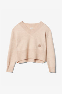 Totême Fornells knitted wool sweater. Shop at Birger Christensen.