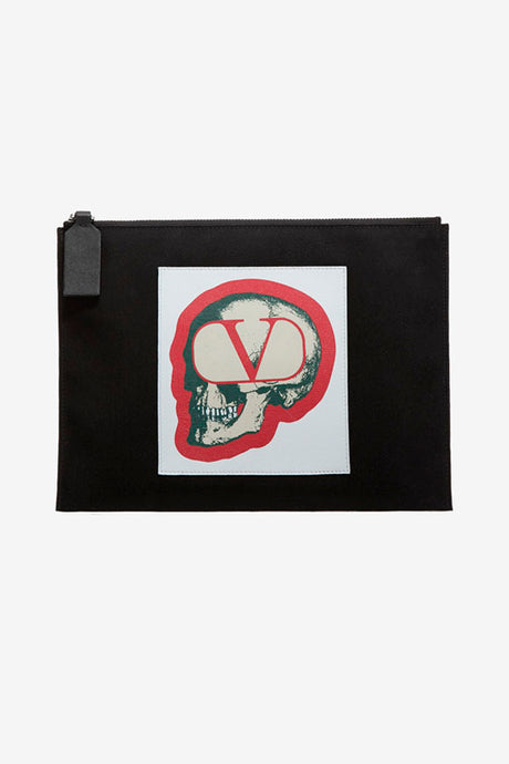 Pouch in black nylon, with a zipper fastening across the top. The front holds a skull graphic, on a red and white background.