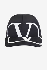 Baseball cap in black polyester, with a adjustable back. On the front is a large VLOGO Valentino graphic.