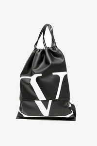 Backpack in black calfskin with leather drawstring closing. Front holds a VLOGO graphics.