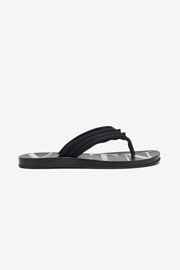 Sandals in black rubber, with white VLTN graphic.