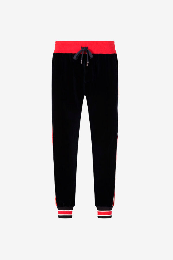 Jogging pants in navy and red velvet. The waist has stretch drawstring fastening and stretch ankle cuffs.