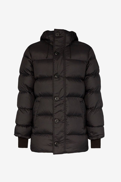 Lightweight down filled jacket in black, with a military-inspired buttons. The jacket has a high neck and knit ribbed cuffs.