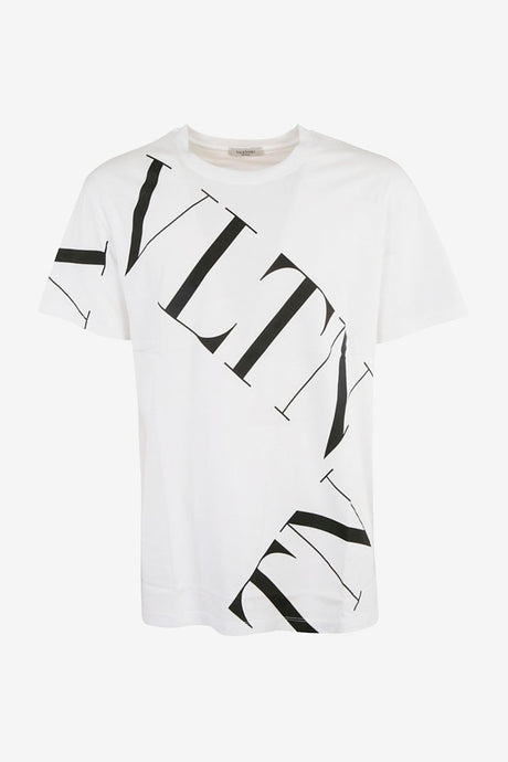 Short sleeve t-shirt in white cotton. Across the front and shoulder is printed VLTN in black.