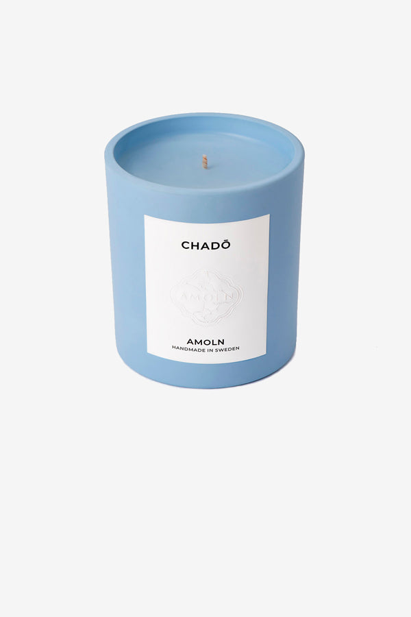 Scented candle in a light blue color