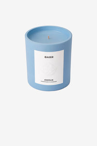 Scented candle in a light blue color and have a scent like forrest