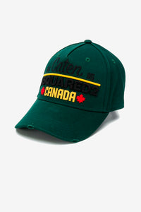 Green baseball cap with worn look, DSQUARED2 embroidered logo in black and CANADA print in yellow.