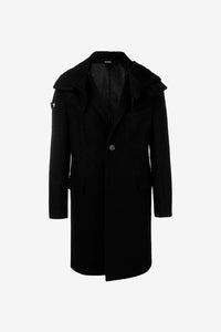Long coat in black wool with a single button fastening. The coat has a large hood, military inspired shoulder details and two pockets.