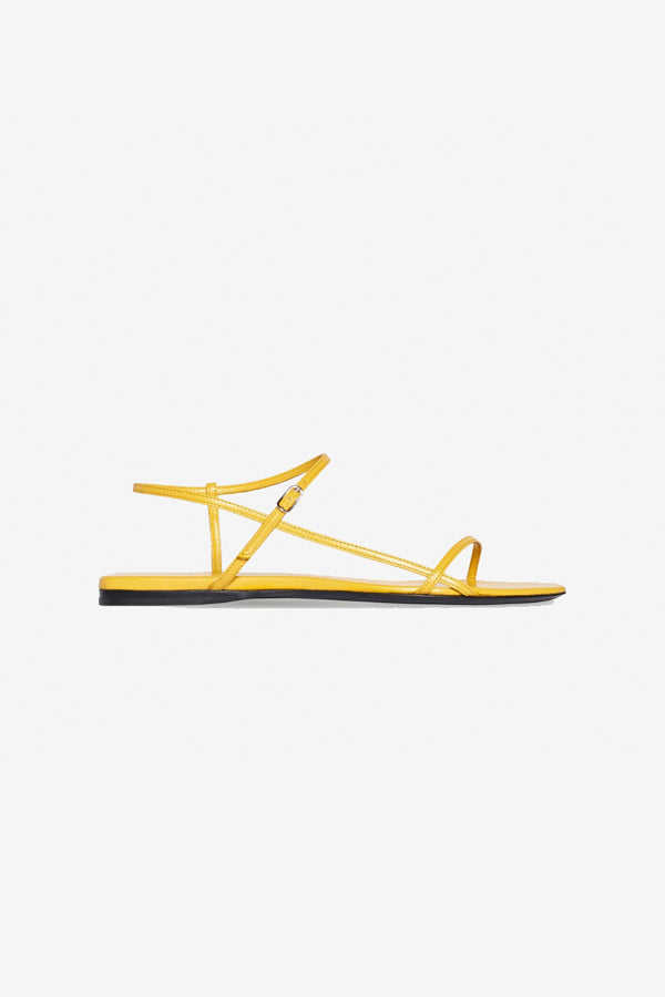 The Row flat Bare Sandal in mustard yellow leather