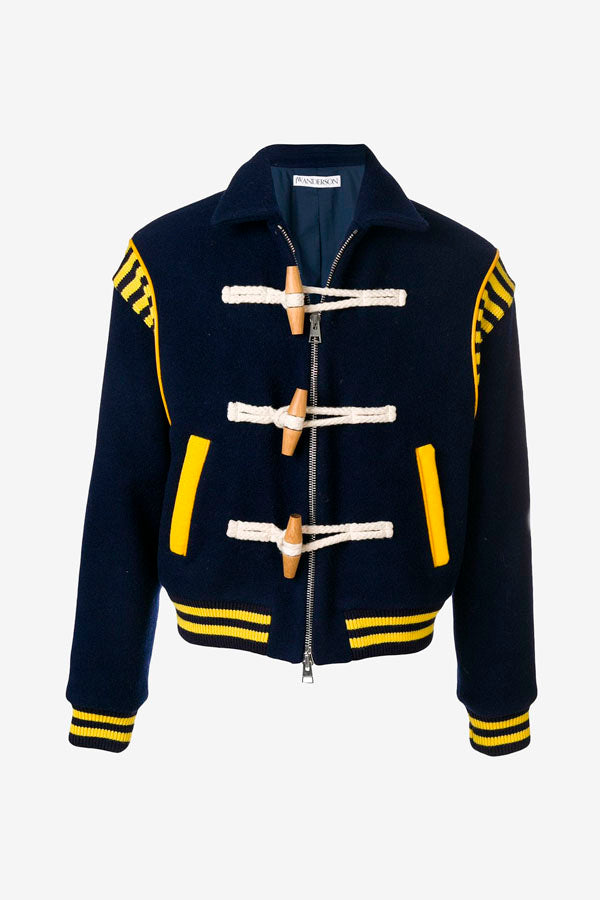 Blue jacket with yellow details, zipper and toggle fastening.