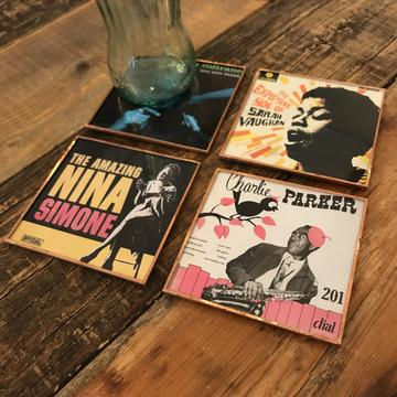 Coasters made from reclaimed glass and copper featuring images of jazz musicians