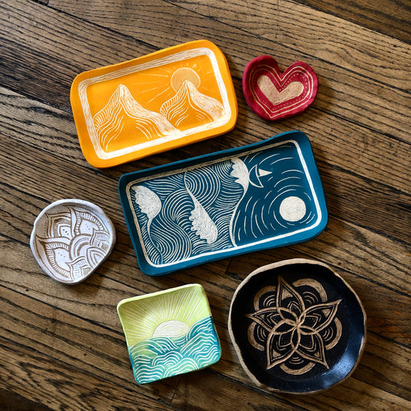 Hand-engraved sgraffito trays.