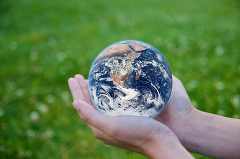 eco friendly globe in two hands