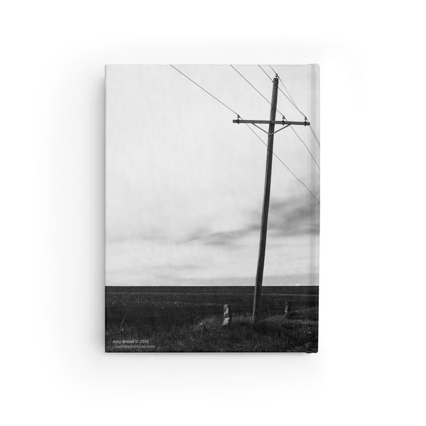 Electric Pole Crosses Journal