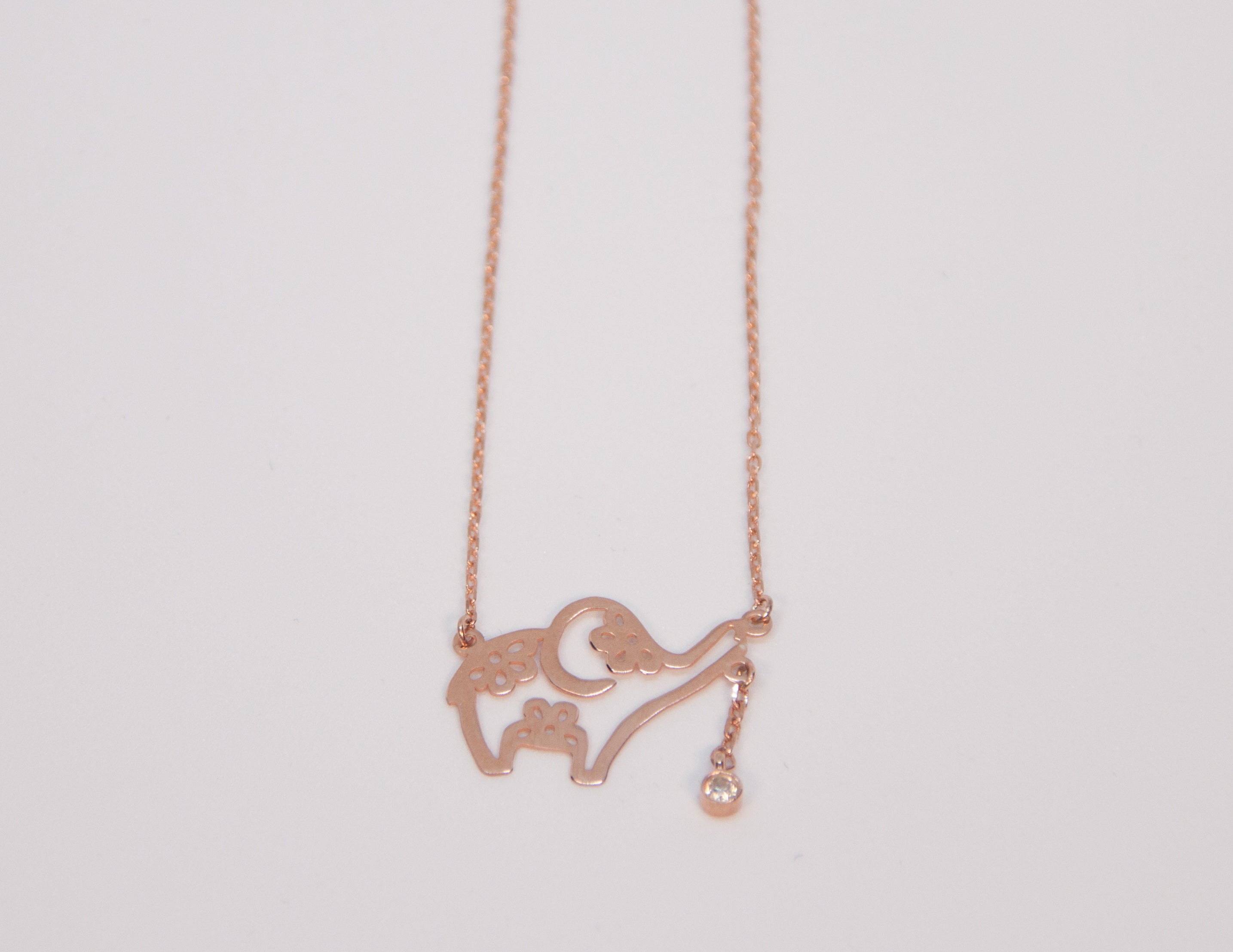 elephant necklace with flower and diamond details