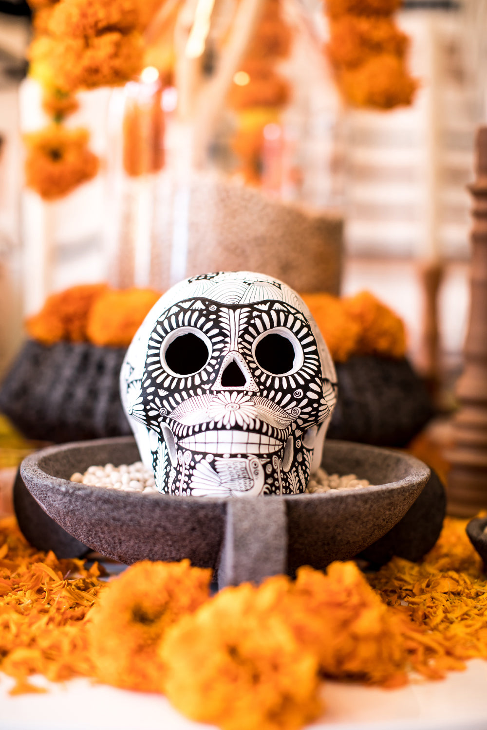 black and white hand painted Mexican skull day of the dead altar día de los muertos ofrenda