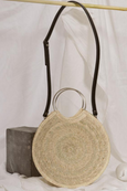 round woven palm crossbody bag made in Mexico with round silver metal handles and black leather strap