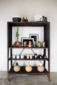 black tree of life candelabra on shelf display