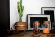 tripod wood planter, glass containers, and lacquered platters