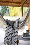 ceramic tripod planter, 2 ceramic tumblers, hammock with blanket and pillows
