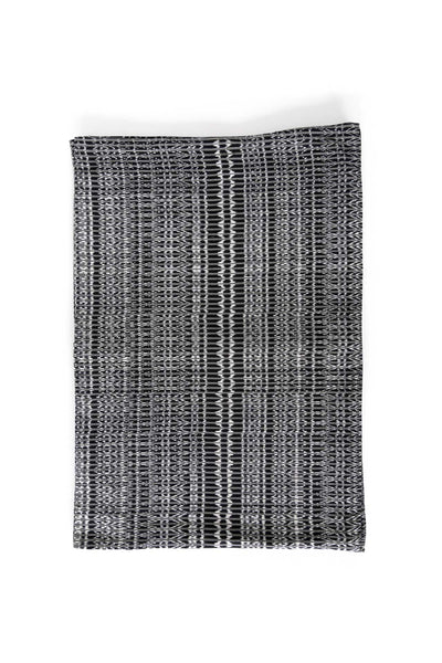 hand-woven black and white cotton ikat placemat