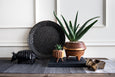 estoperoles planter, tripod wood planter, black glazed platter, and ceramic animal figurines