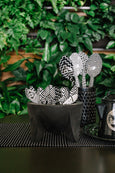black and white enamel spoons with graphic pattern