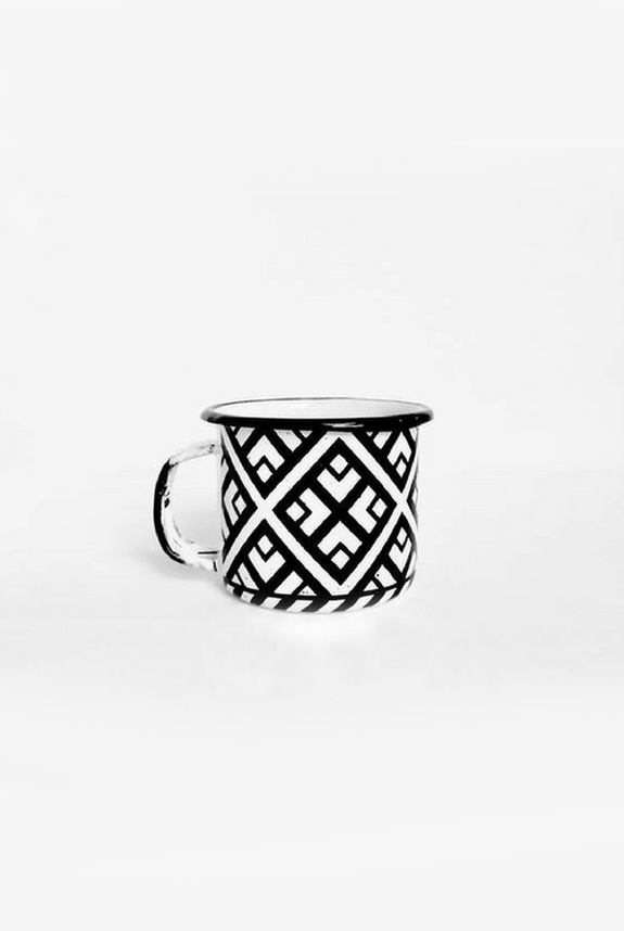 black and white enamel espresso cup with graphic pattern