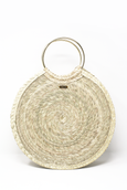 round woven palm crossbody bag made in Mexico with round gold metal handles and brown leather strap