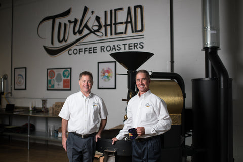 Jim and Joe Lamont III in from of the Roaster.