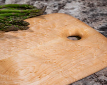 Smooth surface on a Birdseye Maple cutting and serving board