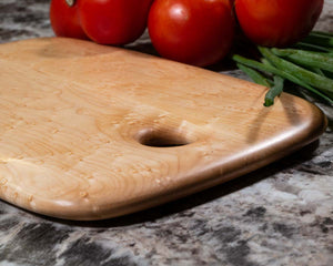Smooth edge profile and corners on a Birdseye Maple cutting and serving board