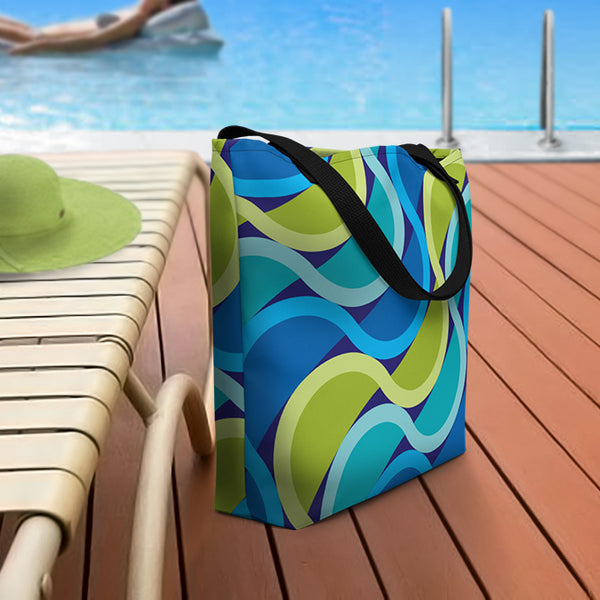 Mid Century Modern Grape SunKissed Beach Bag on a pool deck