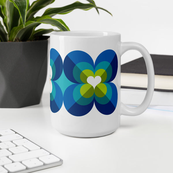 Mid Century Modern Aqua Blue LoverLeaf 15oz Mug side view on a desk
