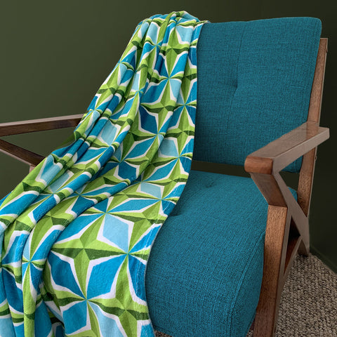 Mid Century Modern Aqua Green PolaRise Throw Blanket on a chair