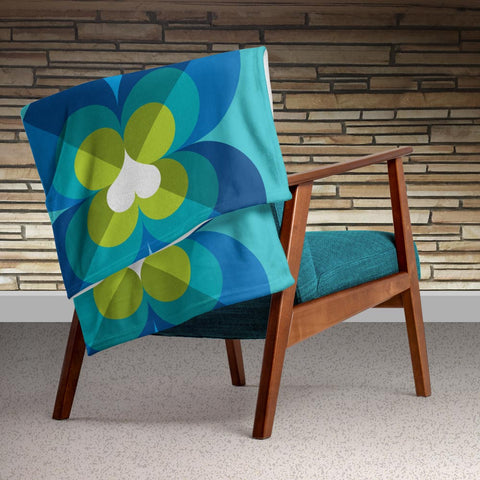 "Mid Century Modern Aqua Blue LoverLeaf 50"" x 60"" Throw Blanket on an armchair"