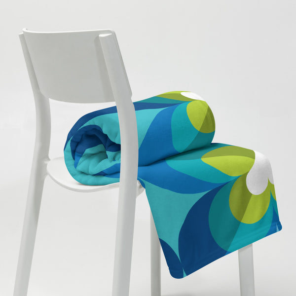 "Mid Century Modern Aqua Blue LoverLeaf 50"" x 60"" Throw Blanket rolled on a chair"