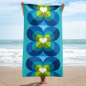 Mid Century Modern Blue Aqua LoverLeaf Beach Pool Towel held up on the beach