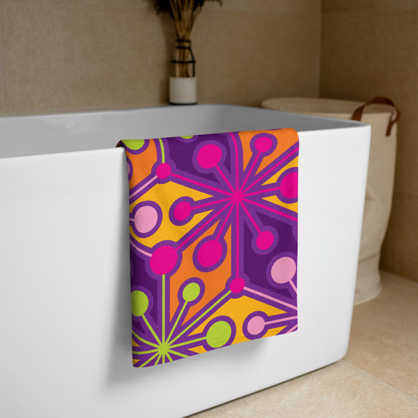 Mid Century Modern PsychoFlakes Beach and Pool Towel on a Tub