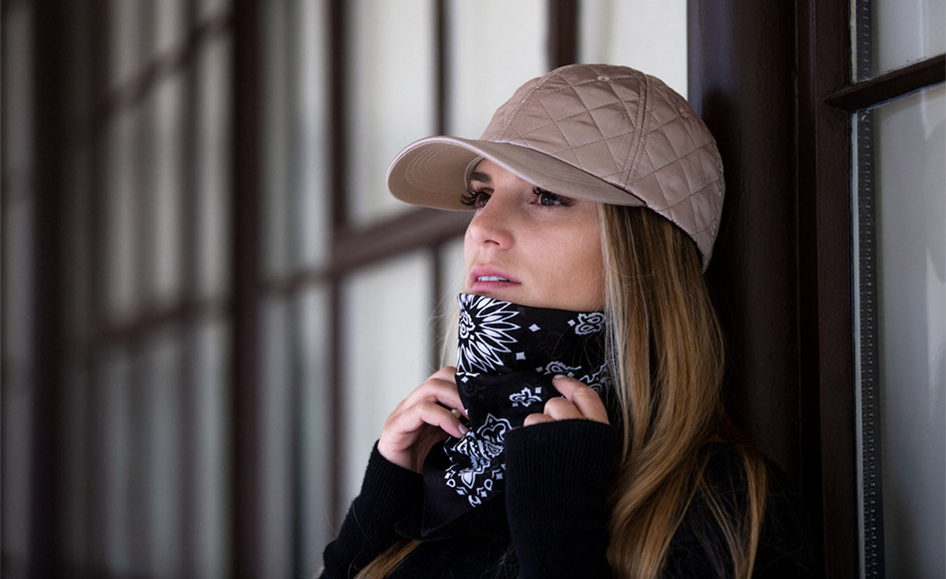 The Parisian quilted blank dad hat in champagne on girl next to windows by Blvnk Headwear